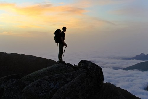 France_Corsica GR20 trekker silhouette with sunrise and cloud sea.jpg