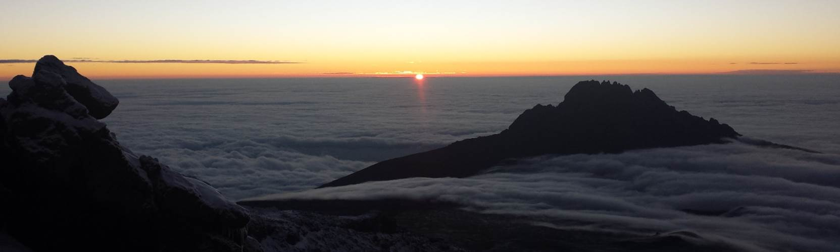 Sunrise on Kilimanjaro with Mawenzi in foreground