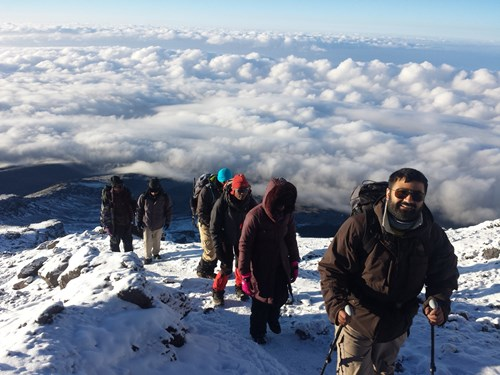 Trekking above the clouds on Kilimanjaro