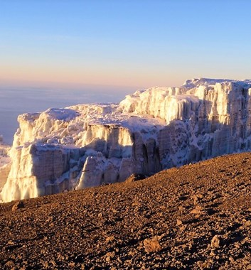On the summit day of Kilimanjaro, you get to see the first of the famous glaciers as you approach the crater rim. Beautiful with the dawn sun on the white ice.